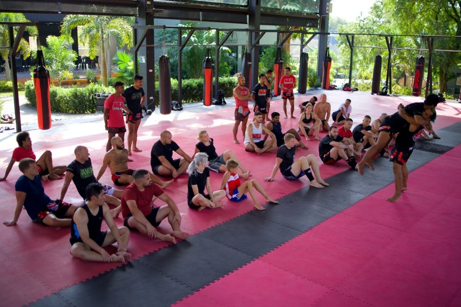 Students watching lesson in Muay Thai gym